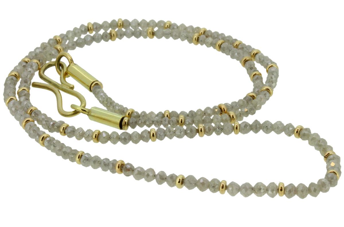 Collier, aus Diamanten mit goldenen Linsen